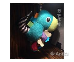 Игрушка TOMY Lamaze Динозавр